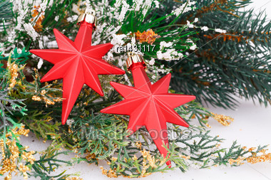 Christmas Decoration With Red Stars And Fir-tree Branch Stock Photo