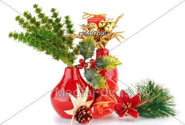 Christmas Decoration In Red Vases Isolated On White Background Stock Photo