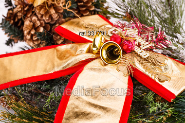 Christmas Decoration Ribbon And Bells With Fir Tree Branch Stock Photo