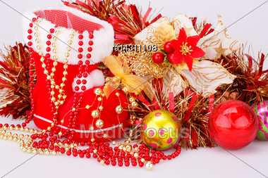 Christmas Decoration With Santa's Red Boot, Garland, Balls, Beads Closeup Picture Stock Photo