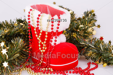 Christmas Decoration With Santa's Red Boot And Green Garland On Gray Background Stock Photo