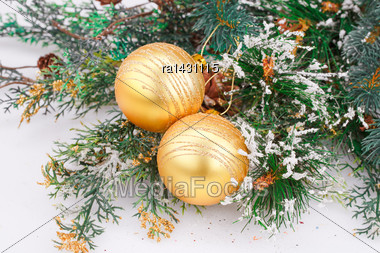 Christmas Decoration With Yellow Balls And Fir-tree Branch Stock Photo