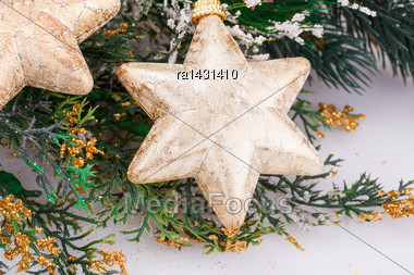 Christmas Decoration With Yellow Stars And Fir-tree Branch Stock Photo