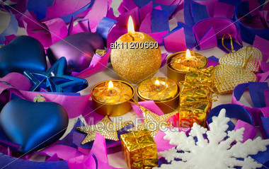 Christmas Decorations And Candles Over Blue Background Stock Photo