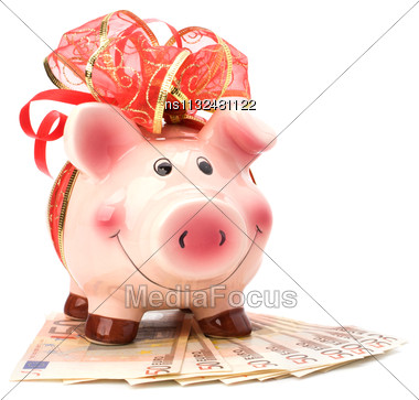 Christmas Deposit Concept. Piggy Bank With Festive Bow Isolated On White Stock Photo