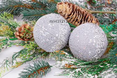Christmas Gray Balls, Cones, Fir-tree Branch On Gray Background Stock Photo