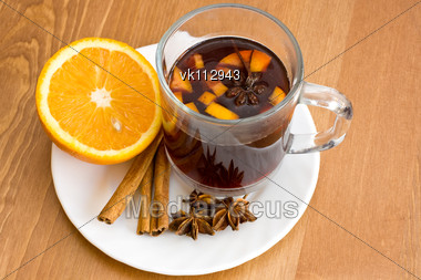 Christmas hot wine with oranges on wooden table Stock Photo