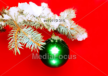 Christmas And New Year Decoration- Balls With Real Snow-covered Fir Branches .On Red Background Stock Photo