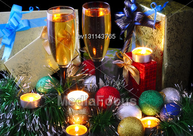 Christmas And New Year Decoration- Balls, Tinsel, Candel And Glasses Of Champagne .On Black Background Stock Photo