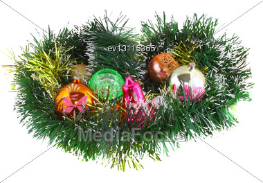 Christmas And New Year Decoration- Glass Balls, Green Tinsel . Close-Up. On White Background, Isolated Stock Photo