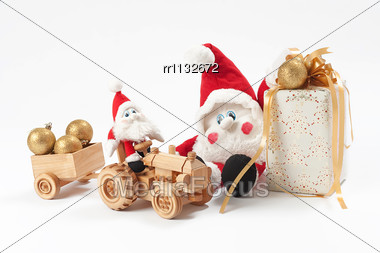 Christmas Present, Two Gnomes And Toy Tractor Stock Photo