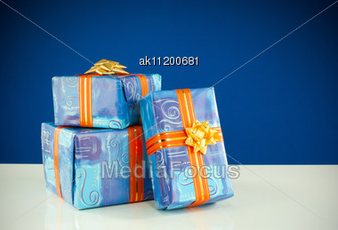 Christmas Presents Against Blue Background Stock Photo