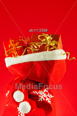Christmas Presents In The Bag Against Red Background Stock Photo
