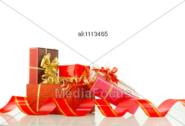 Christmas Presents In Red Boxes Stock Photo