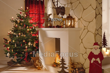 Christmas Tree Beside A Fireplace & Christmas Decorations Stock Photo