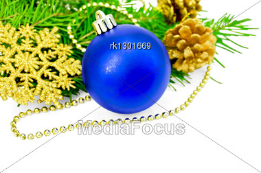 Christmas Tree Blue Ball, Golden Cones, Snowflakes And Beads, Green Fir Branches Stock Photo