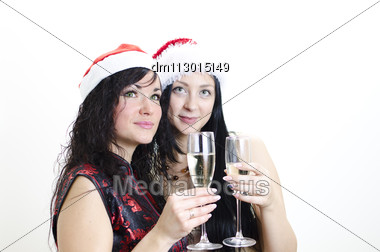 Christmas: Two Girls In Red Hat Have Fun Stock Photo