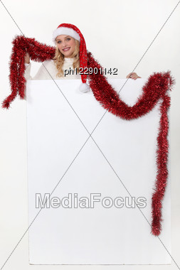 Christmassy Woman With A Board Left Blank For Your Message Stock Photo
