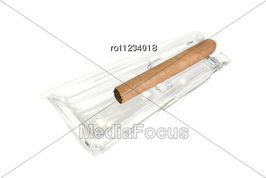 Cigar At Ashtray Isolated On A White Back Stock Photo