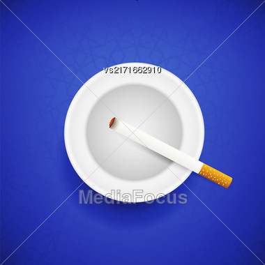 Cigarette And Ashtray On Blue Geometric Background. Top View Stock Photo