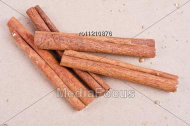 Cinnamon Stick Closeup On A Brown Background Stock Photo