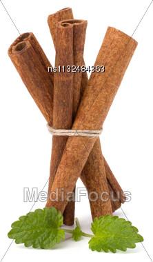 Cinnamon Sticks And Fresh Bergamot Mint Leaf Isolated On White Background Stock Photo