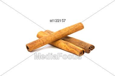 Cinnamon Sticks On White Stock Photo