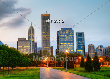 Cityscape Of Chicago As Seen From The Central Park In The Evening Stock Photo