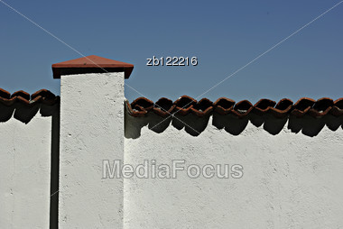 Clear White Wall With Red Tile With Clear Blue Sky In Background. Stock Photo