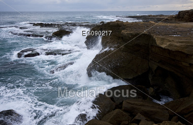 Cliff with waves crushing against the rocks Stock Photo
