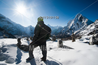 Climber And Cho La Pass At Daybreak In Himalayas. Trekking In Nepal. Beautiful Native Lens Flare Effect Stock Photo
