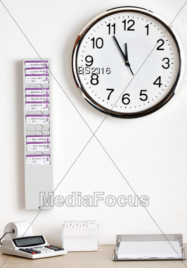 Clock, Time Card & Desk With Calculator Stock Photo