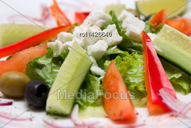 Close-up Of Appetizing Salad In A Plate On White Background Stock Photo