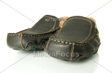 Close-up Of Black Mens Shoes Moccasins Over White. Wide-angle Shot. Stock Photo