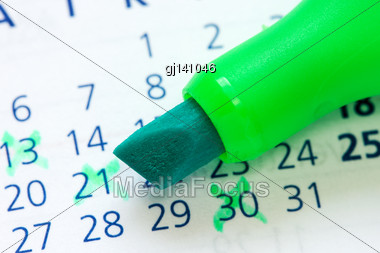 Close Up Of A Calendar And Green Marker Stock Photo