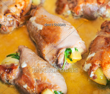 Close-up Of Chicken Roll With Herbs And Cheese Stock Photo