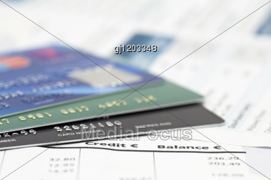 Close-up Of Credit Cards On Bank Invoice Stock Photo