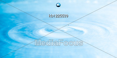 Close Up Drop Of Water Blue Color Stock Photo