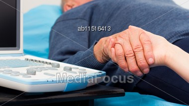 Close-up Of Elderly Patient's Hand Held By Kind Doctor Stock Photo