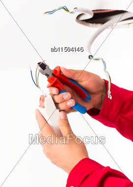 Close-up Of Electrician's Hands Mounting Power Supply For Led Ceiling Lamp Stock Photo