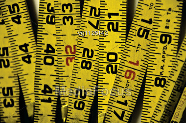Close Up Of A Few Old Vintage Measuring Tapes Stock Photo