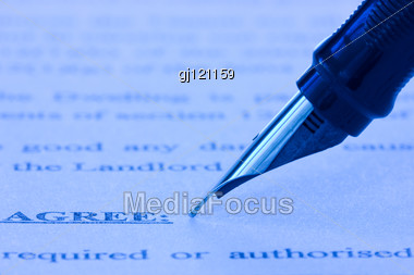 Close-up Of Fountain Pen And Printed Agreement Stock Photo