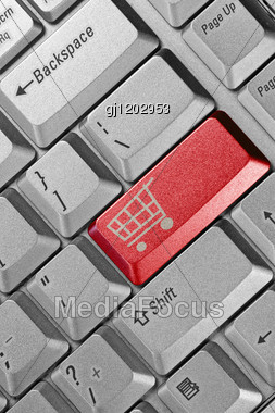 Close Up Of Keyboard With Shopping Cart On A Button Stock Photo