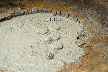 A Close Up Look At A Mud Volcano Boiling Stock Photo