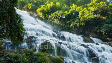 Close Up Maeya Water Fall Of Chiangmai Thailand With Sun Light Stock Photo