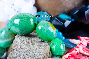 Close Up Of Many Different Colorful Natural Gems: Agate Onyx, Coral Stock Photo