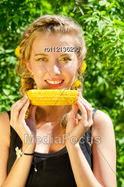 Close-up Outdoor Portrait Of Young Beauty Woman Eating Corn-cob Stock Photo