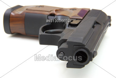 Close Up Of A Pistol A Target And Cartridges Is Isolated Stock Photo
