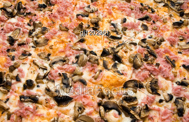 Close-up Of Pizza With Ham And Mushrooms Stock Photo