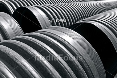 Close Up Of The Plastic Black Pipes Stacked Outside, Suitable As Abstract Background Stock Photo